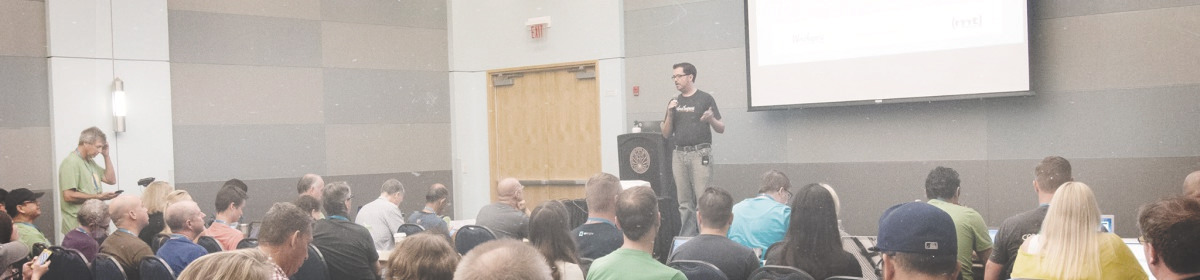 Wide landscape image of Matt Cromwell presenting on a relevant WordPress topic at WordCamp Los Angeles 2015