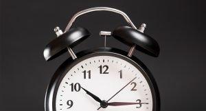 a clock on a dark grey background